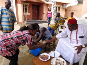 Ojiudo traditioally welcoming a guest to his Umatu
