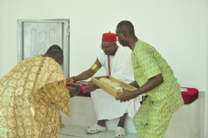Agbogidi playing the role of a humble servant by sharing food hand by hand