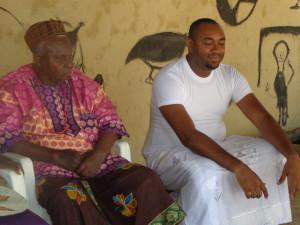 Ezeozo siiting beside his father Akunwata Okosi
