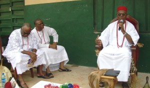 The Obi-of-Onitsha, Igwe Alfred Achebe (right) speaking on    the issue of drug abuse in youths while flanked by two of his cabinet    chiefs.